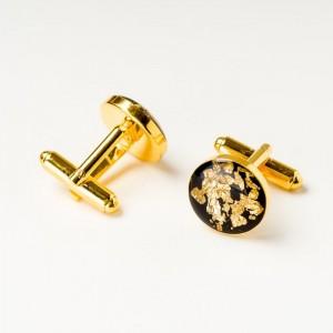 Złote spinki do mankietów